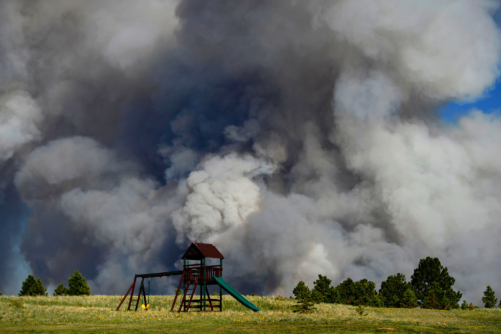 Description of . COLORADO SPRINGS, CO - JUNE 11: Playground equipment sits in an evacuated neighborhood as the Black Forest fire burns east of Colorado Springs. (Photo by AAron Ontiveroz/The Denver Post)