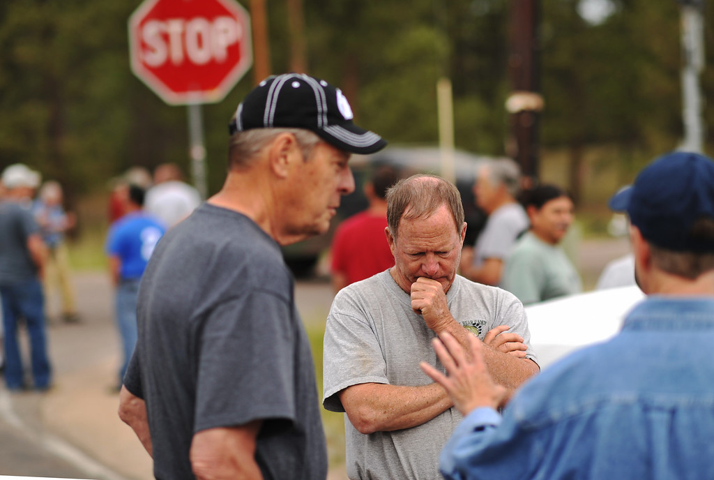 Description of . Rich West, front center, and evacuees of Black Forest fire are waiting El Paso County Sheriff\'s escort to their property at the corner of Vollmer Rd. and Burgess Rd. Colorado Springs, Colorado. June 14, 2013.  (Photo By Hyoung Chang/The Denver Post)