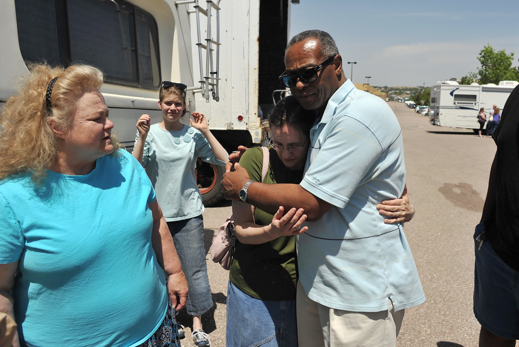 Description of . COLORADO SPRINGS, CO. - June 12: Rev. Jimmy Lilley of Mercy Springs, right, comforts Black Forest Fire evacuee Elly, 28, at the parking of Walmart in Colorado Springs. Evacuees Deborah Bowin, left, and her husband Larry and Elly and 7 foster children spend over night at the parking. Colorado Springs, Colorado. June 12, 2013. (Photo By Hyoung Chang/The Denver Post)
