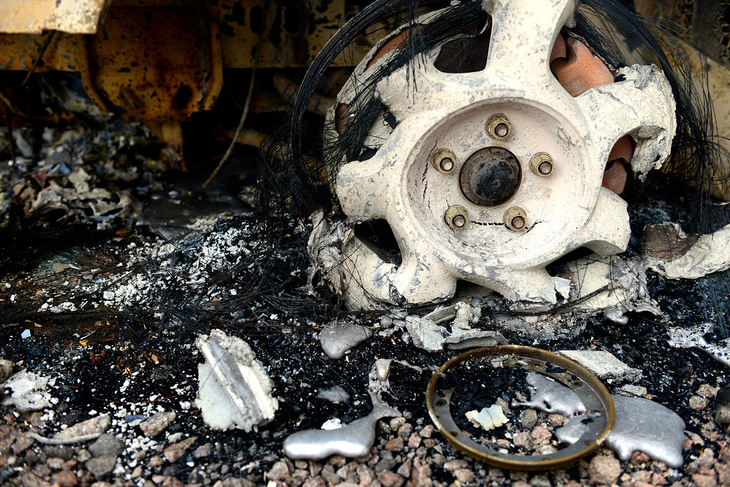 Description of . COLORADO SPRINGS, CO - JUNE 18: The melted rim of a Ford T-Bird on a rental property owned by Jesse Russow, which was the southernmost home burned on the west side of Vollmer Road. The occupant of the home, who was not named, was only able to save himself and his motorcycle as he was away from the property when the evacuation took place. Russow is accepting donations for fire crews at 7195 Templeton Gap Road in Colorado Springs. (Photo by AAron Ontiveroz/The Denver Post)