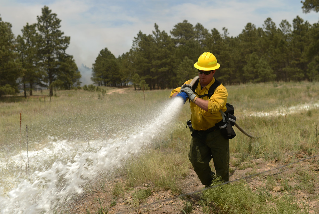 Description of . COLORADO SPRINGS, CO. - June 13: Dave Caulfield of Air Force Academy fire department is preparing for back burning at Black Forest section 16 trailhead. Colorado Springs, Colorado. June 13, 2013. The Black Forest fire has already destroyed at least 360 homes and consumed 15,000 acres. (Photo By Hyoung Chang/The Denver Post)