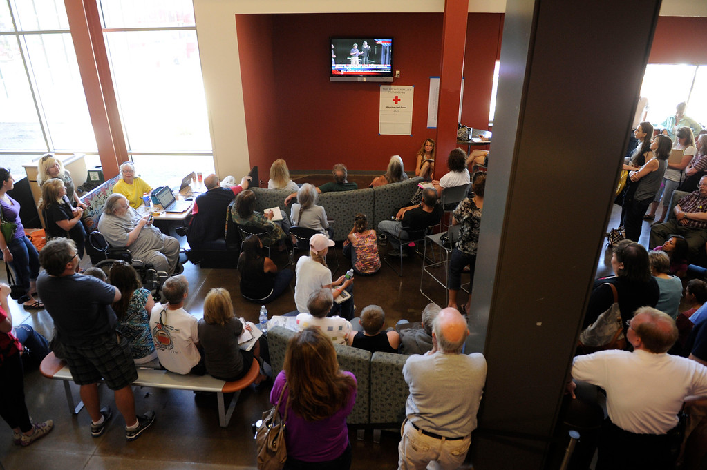 Description of . An overflow crowd gathered to watch a television feed during a community meeting for Black Forest fire evacuees at Palmer Ridge High School Saturday morning, June 15, 2013. (Photo By Andy Cross/The Denver Post)