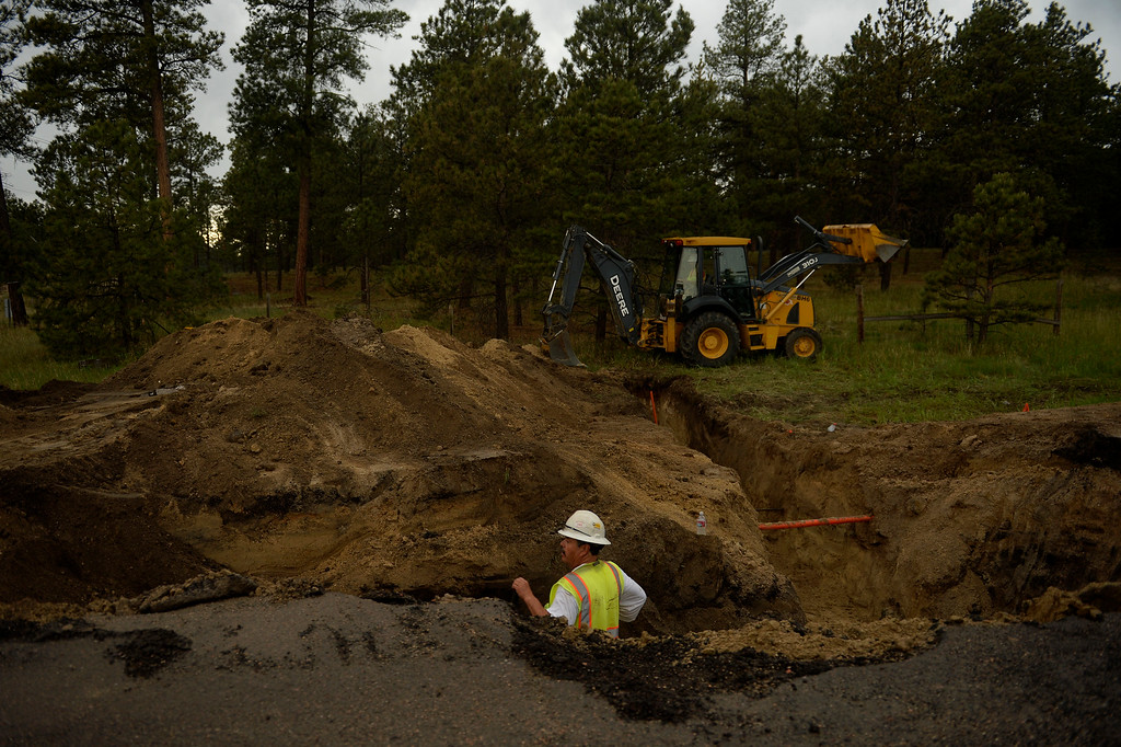 Description of . COLORADO SPRINGS, CO. - June 14: Utility workers work to restore services to the the Black Forest Fire area near Colorado Springs, Colorado. June 14, 2013 Denver, Colorado Springs. (Photo By Joe Amon/The Denver Post)