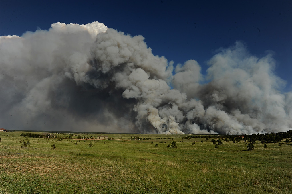 Description of . COLORADO SPRINGS, CO - JUNE 11: A wall of dark smoke looms large over the horizon as fire destroys the landscape looking south from Mountain Dance Drive and Open Sky Way northeast of Colorado Srpings, CO on June 11, 2013. The Black Forest fire started around 1:45 in an area of the Black Forest northeast of Colorado Springs, CO. Homes have already burned and the wind is expected to continue through the afternoon. Photo by Helen H. Richardson/The Denver Post) 12
