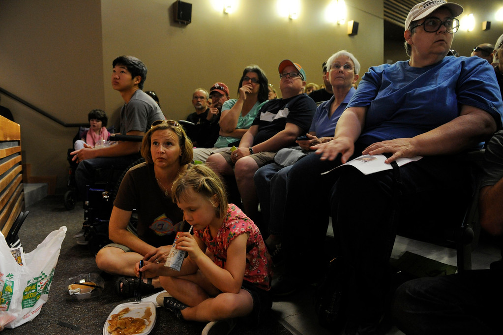 Description of . A packed house for a community meeting for Black Forest fire evacuees in search of current developments from local officials at Palmer Ridge High School Saturday morning, June 15, 2013. (Photo By Andy Cross/The Denver Post)