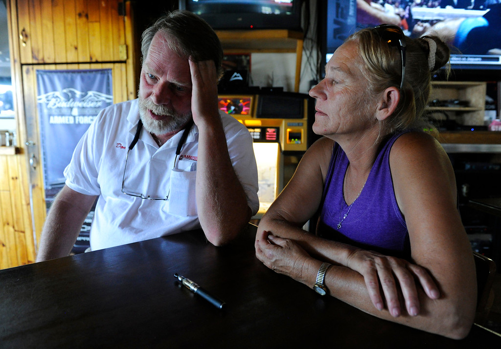 Description of . Black Forest Fire evacuee, Don Callender, left, and his girlfriend, Judy McDowell, reflect on the loss of their home due to the fire from O\'Malley\'s Steak Pub in Palmer Colorado Saturday, June 15, 2013. Earlier, both attended a community meeting at Palmer Ridge high School to gather more information as to when they can go and see their home, a rental, but was destroyed. (Photo By Andy Cross/The Denver Post)