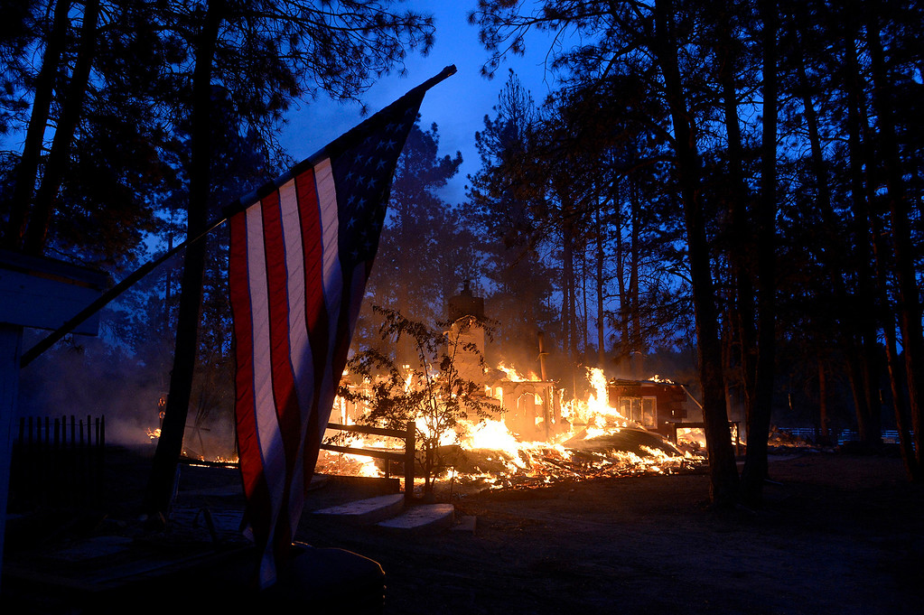 Description of . Pat Turner\'s home on Tia Lane burns to the ground in the Black Forest fire on June 12, 2013. The Turner family had lived there for 49 years.