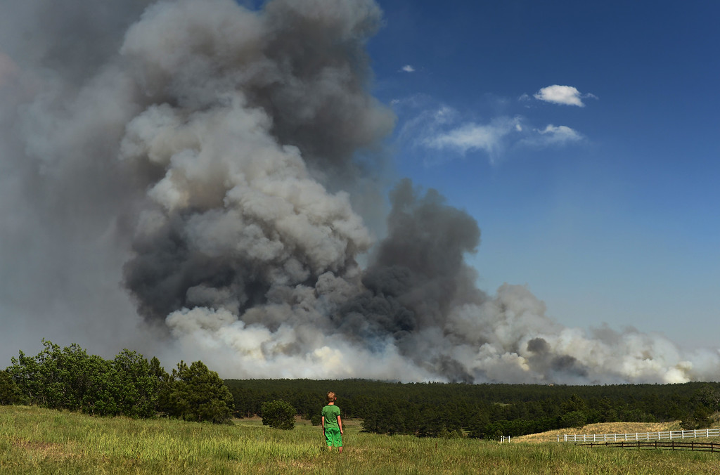 Description of . Colorado Springs, CO. - June 11: Floyd Kerr Jr., 7, of Colorado Springs is watching the smoke cover BLack Forest area. Colorado Springs, Colorado. June 11, 2013. The fire is about 15 acres near the 12600 block of Peregrine Way near Black Forest Regional Park. (Photo By Hyoung Chang/The Denver Post)