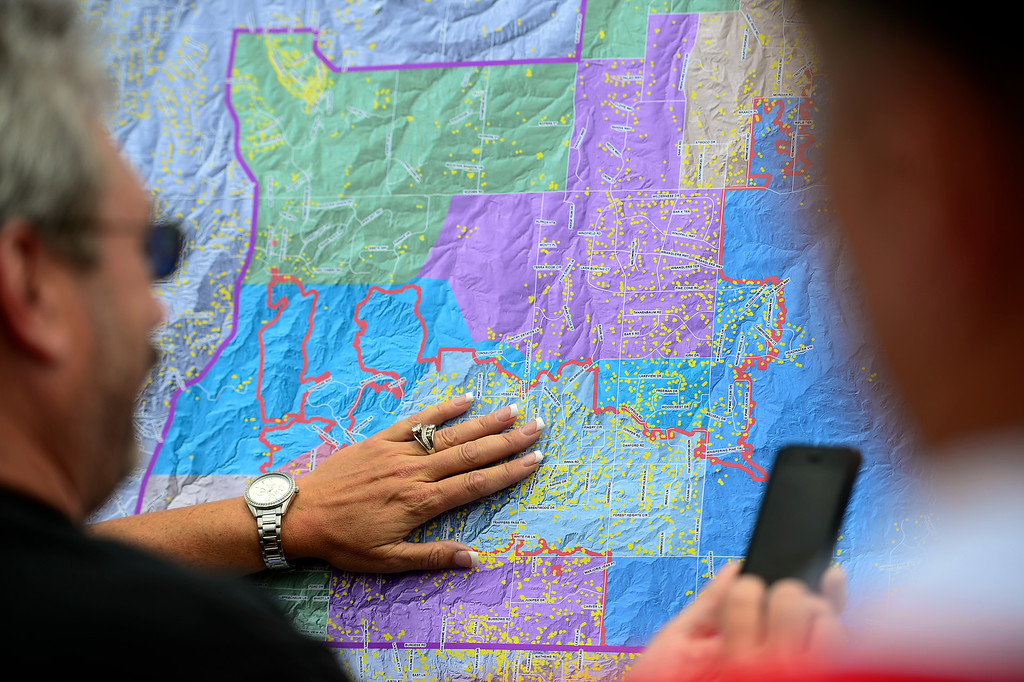 Description of . COLORADO SPRINGS, CO - JUNE 18: Residents look at a map as Sheriff Terry Maketa explains it to them during a press conference held by the El Paso County Sheriff to inform residents of their re-admittance status. Residents in Cathedral Pines were allowed in by 2 p.m., while residents between Vollmer and Herring Roads and Black Forest and Herring Roads both locations between Shoup Road and Kirk Road north-south will be allowed in for three hours. (Photo by AAron Ontiveroz/The Denver Post)