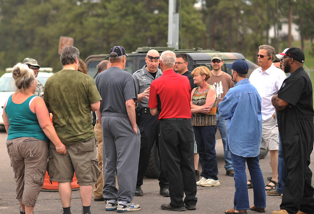 Description of . COLORADO SPRINGS, CO. - June 14: Evacuees ask escort to their property to the El Paso County Sheriff at the corner of Vollmer Rd. and Burgess Rd., Friday June 14, 2013.  (Photo By Hyoung Chang/The Denver Post)