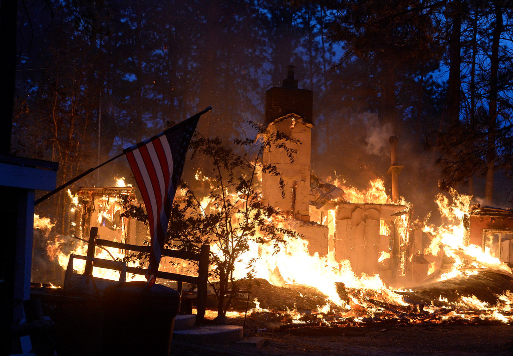 Description of . COLORADO SPRINGS, CO - JUNE 12: A house is fully engulfed with flames in the midst of the Black Forest Fire northeast of Colorado Springs on June 12, 2013.  .   Photo by Helen H. Richardson/The Denver Post)