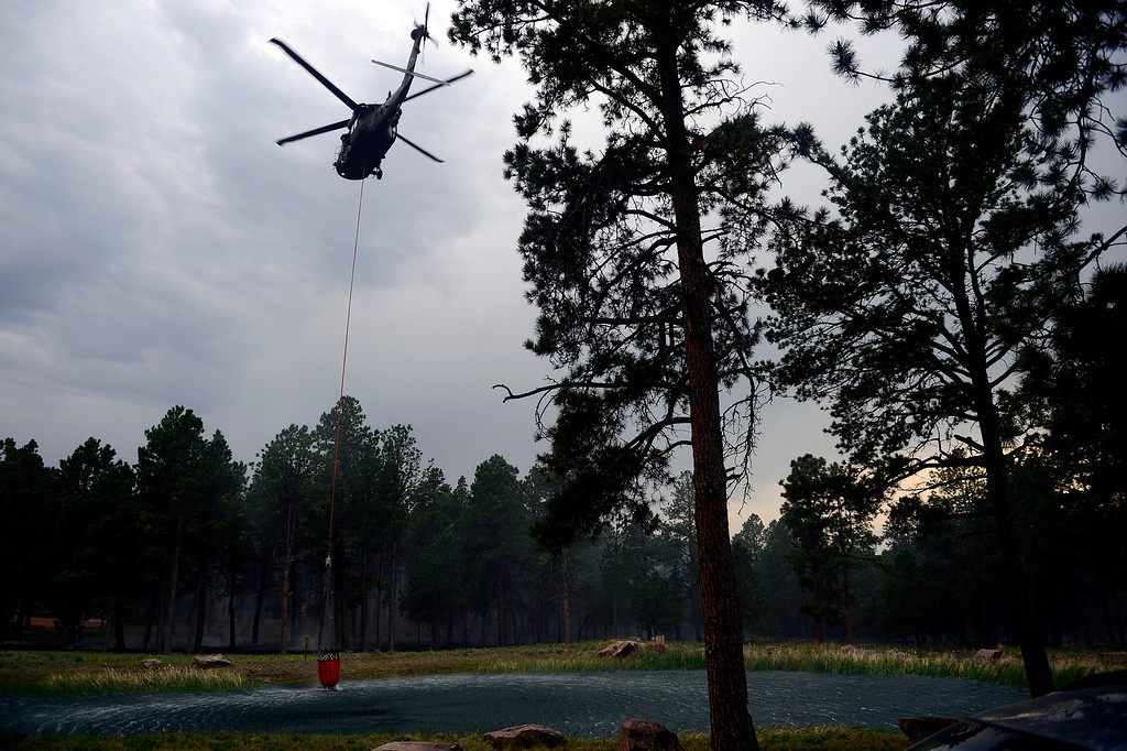 Description of . COLORADO SPRINGS, CO - JUNE 13: A helicopter prepares to fill to fight the Black Forest fire burns east of Colorado Springs. (Photo by AAron Ontiveroz/The Denver Post)