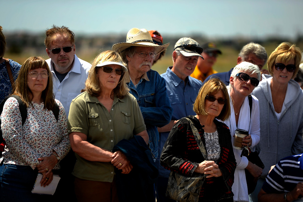 Description of . COLORADO SPRINGS, CO. - June 17: John Adams (in cowboy hat) and his wife Gail (in green) strain to hear during the morning press conference as some residents were allowed back into the northern edge of the Black Forest Fire area near Colorado Springs, Colorado. June 17, 2013 Denver, Colorado Springs. (Photo By Joe Amon/The Denver Post)