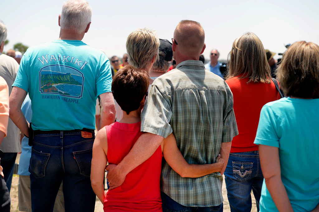 Description of . Black Forest evacuees JP Derewicz, right, and his wife Tracy, left, listen closely to the  press briefing about the Black Forest Fire held for members of the media and for homeowners at Pikes Peak Community College Rampart Range Campus near Monument, CO  on June 15, 2013.  The two, who are living with friends in Monument while evacuated, have not lost their home.  Photo by Helen H. Richardson/The Denver Post)