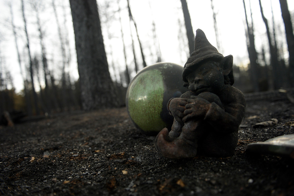 Description of . COLORADO SPRINGS, CO. - June 18: The charred remains of a garden gnome in the rubble of Ted and Teresa Robertson\'s home that was totally taken by the fire as some residents were allowed back to see their homes in the Black Forest Fire area near Colorado Springs, Colorado. June 18, 2013. Colorado Springs. (Photo By Joe Amon/The Denver Post)
