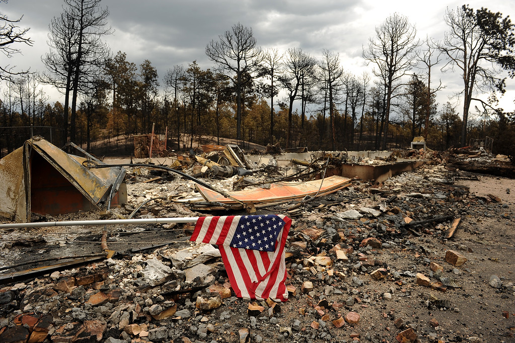 Description of . BLACK FOREST, CO - JUNE 17:   Remnants of a home in the Black Forest Fire on June 16, 2013.  Photo by Helen H. Richardson/The Denver Post)