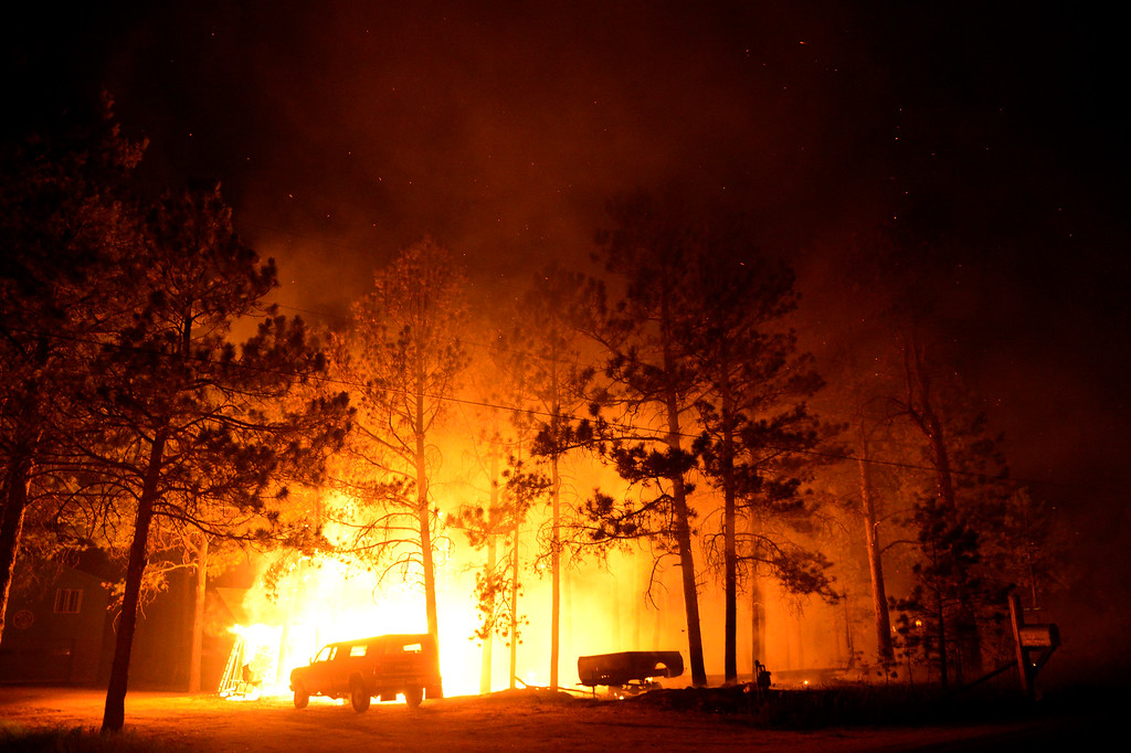 Description of . COLORADO SPRINGS, CO - JUNE 11: A home near Herring and Swan is engulfed in flames as the Black Forest fire burns east of Colorado Springs. (Photo by AAron Ontiveroz/The Denver Post)