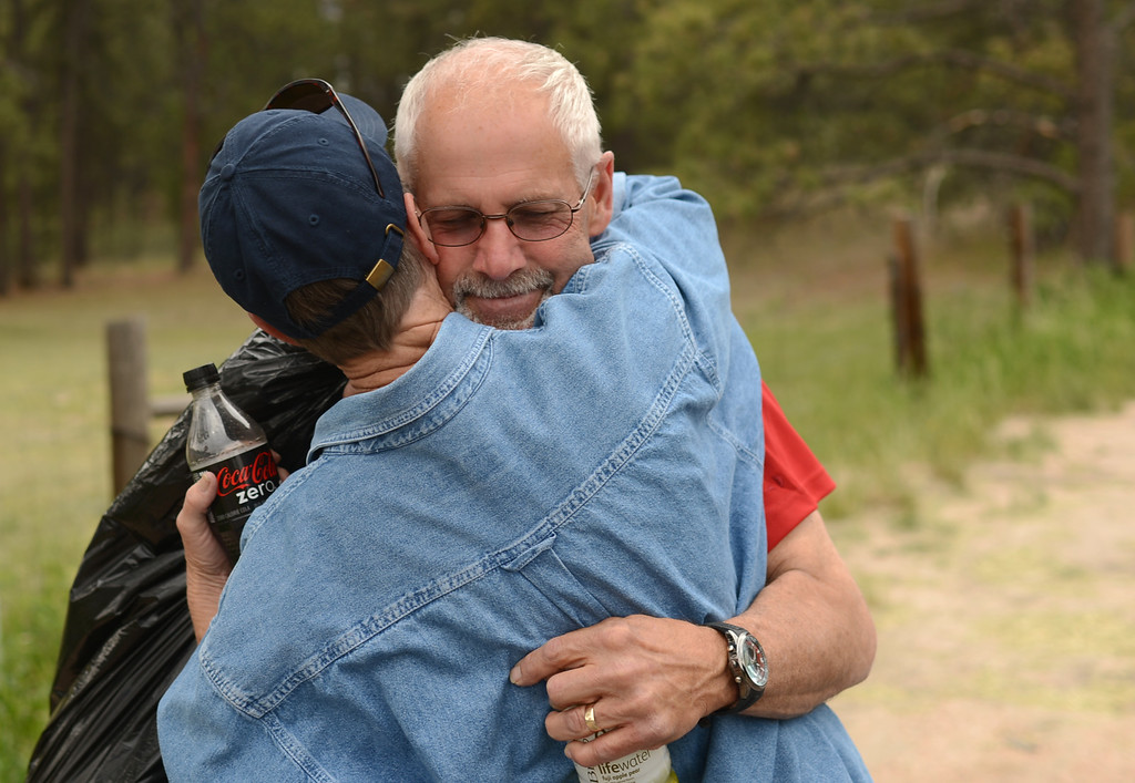 Description of . COLORADO SPRINGS, CO. - June 14: Evacuees Gart Schinderlye, right, hugs Cindy Miller. Schinderlye find out his house was survived after the trip to his property by El Paso County Sheriff\'s escort. Colorado Springs, Colorado. June 14, 2013. Firefighters continue to battle the Black Forest fire north of Colorado Springs that has consumed 15,700 acres and 379 homes. (Photo By Hyoung Chang/The Denver Post)