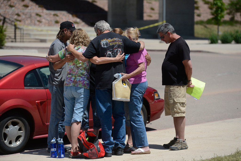 Description of . A group of people in a prayer circle after attending community meeting for current updates on the fire at Palmer Ridge High School in Monument Colorado June 15, 2013. (Photo By Andy Cross/The Denver Post)