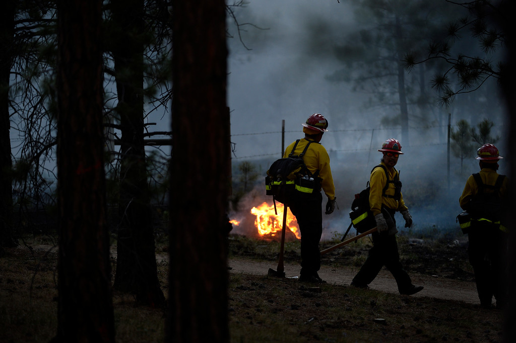 Description of . COLORADO SPRINGS, CO. - June 13: Firefighters back-burn at Black Forest trail head 16 near the corner of Burgess Rd and Buckskin Ln along the edge of the Black Forest Fire Colorado Springs, Colorado. June 13, 2013 Denver, Colorado Springs. (Photo By Joe Amon/The Denver Post)