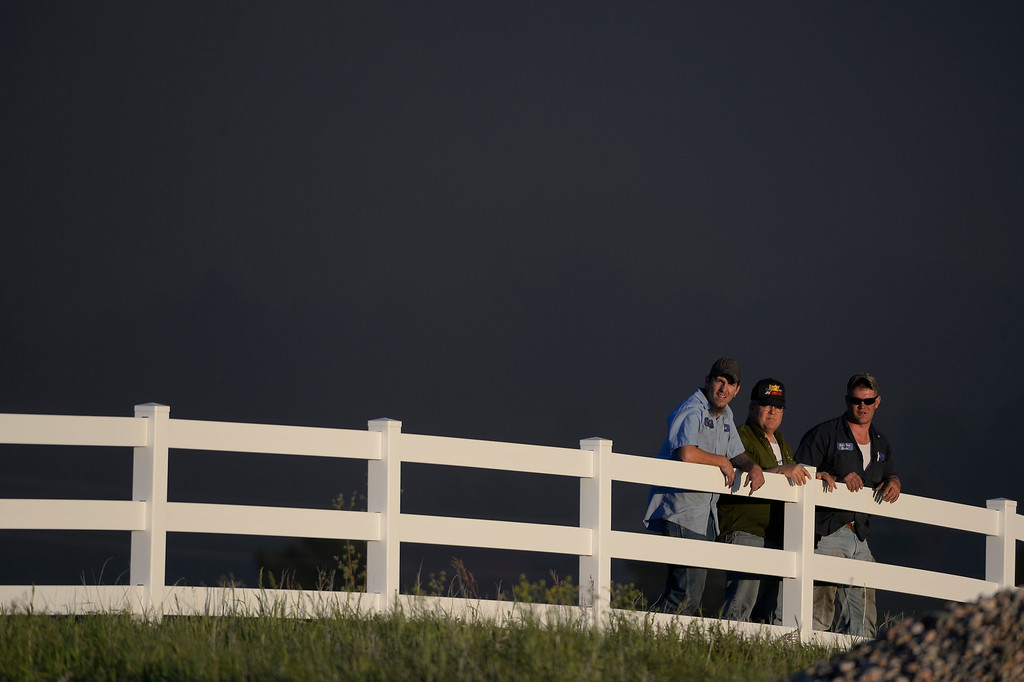 Description of . COLORADO SPRINGS, CO - JUNE 11: Homeowners watch for the advancing fire as they access the danger in the midst of the Black Forest Fire in Colorado Springs, CO on June 11, 2013.. Many homes have already been lost to the raging fire that continues to burn out of control. Photo by Helen H. Richardson/The Denver Post)