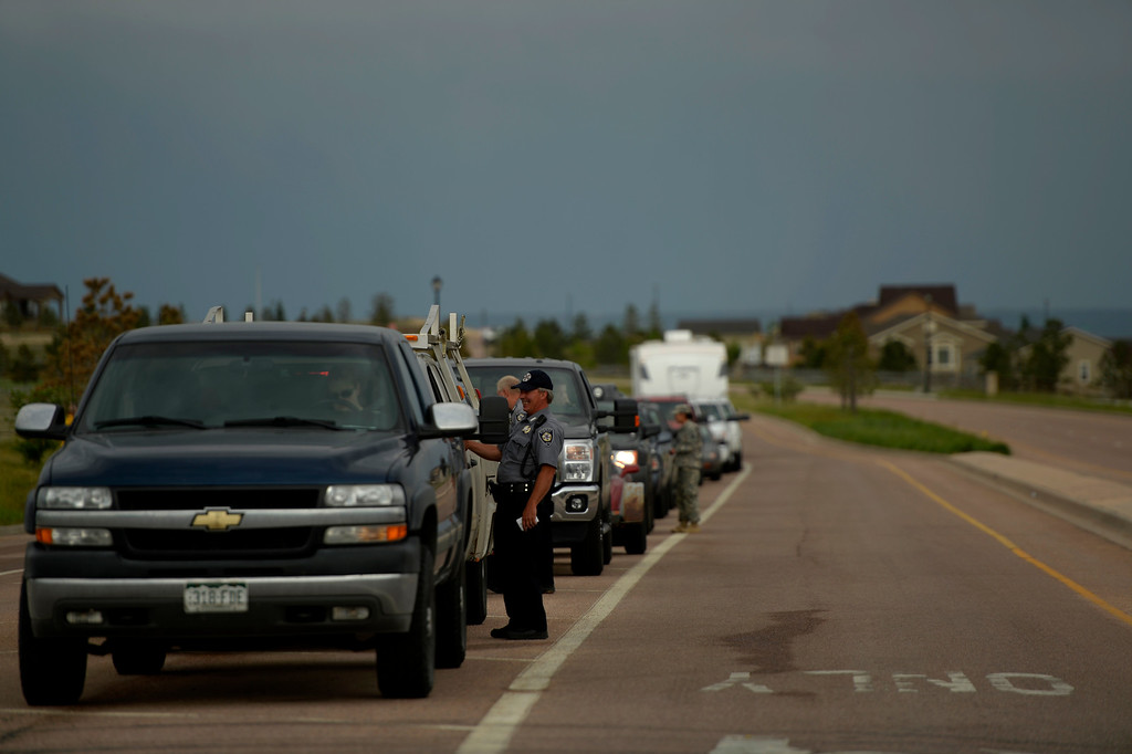 Description of . COLORADO SPRINGS, CO. - June 14: El Paso Sheriffs check ID\'s and get information as some residents were escorted back into the Black Forest Fire area to quickly get medications and important items that were left behind in the rush to evacuate near Colorado Springs, Colorado. June 14, 2013 Denver, Colorado Springs. (Photo By Joe Amon/The Denver Post)