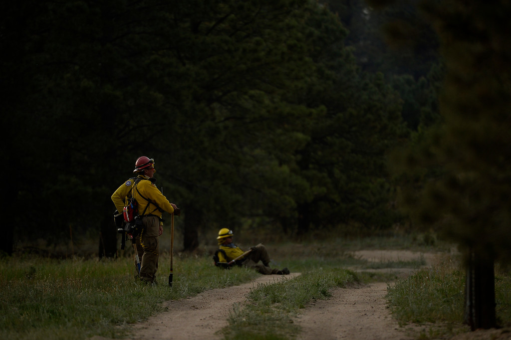 Description of . COLORADO SPRINGS, CO. - June 13: Firefighters get to take a rest at Black Forest trail head section 16 near the corner of Burgess Rd and Buckskin Ln along the edge of the Black Forest Fire Colorado Springs, Colorado. June 13, 2013 Denver, Colorado Springs. (Photo By Joe Amon/The Denver Post)