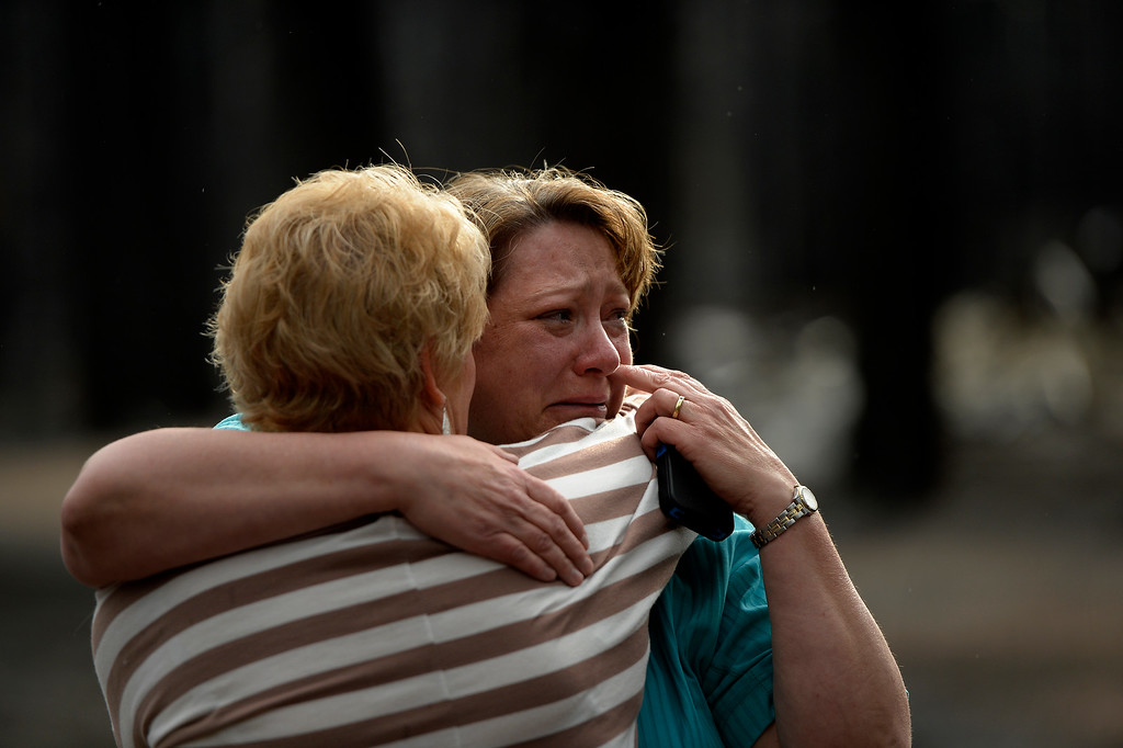 Description of . COLORADO SPRINGS, CO. - June 18: Teresa Robertson wipes away her tears as she is hugged by a neighbor at her home that was totally taken by the fire as some residents were allowed back to see their homes that were burned in the Black Forest Fire area near Colorado Springs, Colorado. June 18, 2013 Denver, Colorado Springs. (Photo By Joe Amon/The Denver Post)