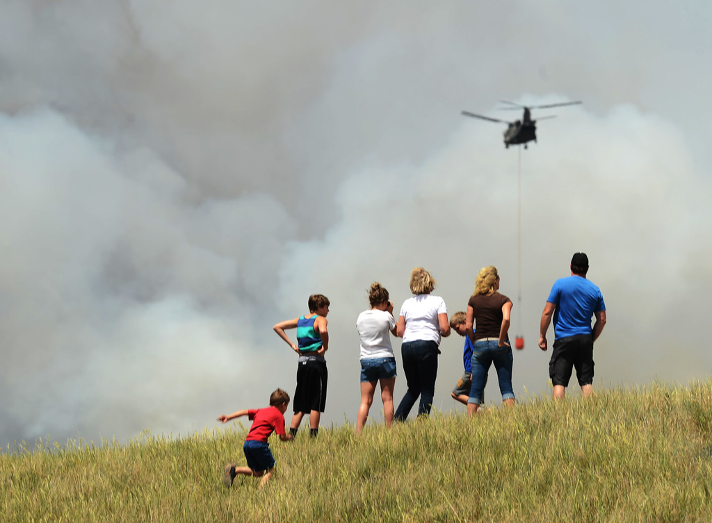 Description of . COLORADO SPRINGS, CO. - June 12: People are watching the Black Forest fire. Colorado Springs, Colorado. June 12, 2013. According to El Paso County Sheriff Terry Maketa, the Black Forest Fire north of Colorado Springs has already burned 80 to 100 homes. (Photo By Hyoung Chang/The Denver Post)
