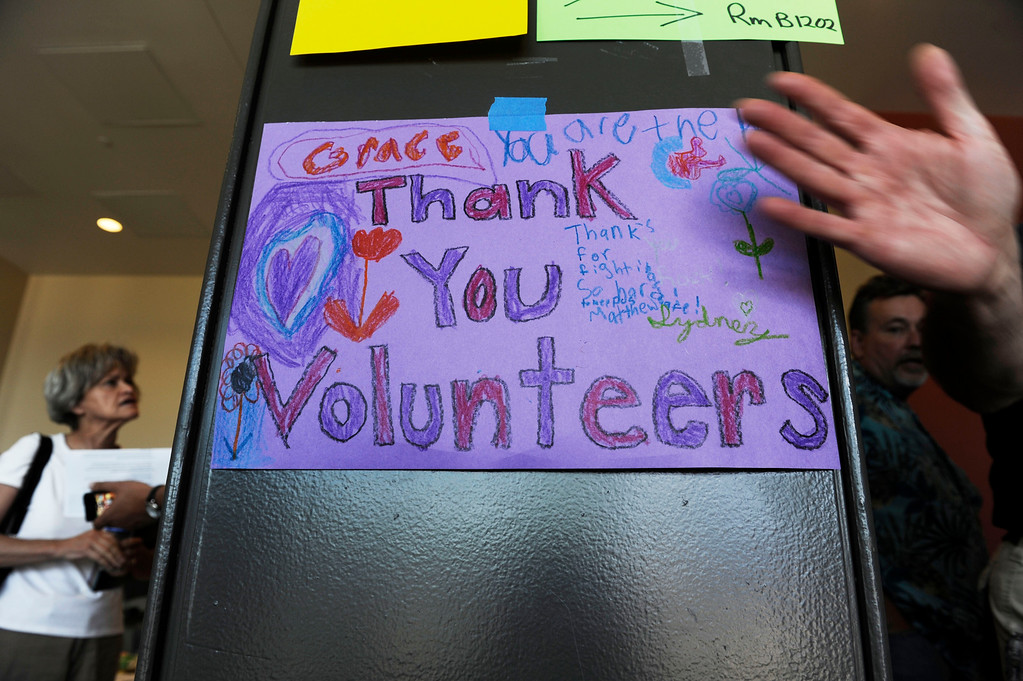Description of . Black Forest Fire evacuees were greeted to  sign thanking volunteers at a community meeting at Palmer Ridge High School in Monument Colorado Saturday, June 15, 2013. (Photo By Andy Cross/The Denver Post)
