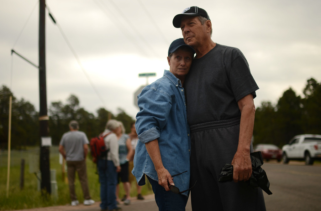 Description of . Black Forest Fire evacuees Cindy Miller, left, and her husband Ray are waiting El Paso County Sheriff\'s escort to their property to pick up their truck at the corner of Vollmer Rd. and Burgess Rd., Friday, June 14, 2013. They lost house by the fire. Firefighters continue to battle the Black Forest fire north of Colorado Springs that has consumed 15,700 acres and 379 homes. (Photo By Hyoung Chang/The Denver Post)