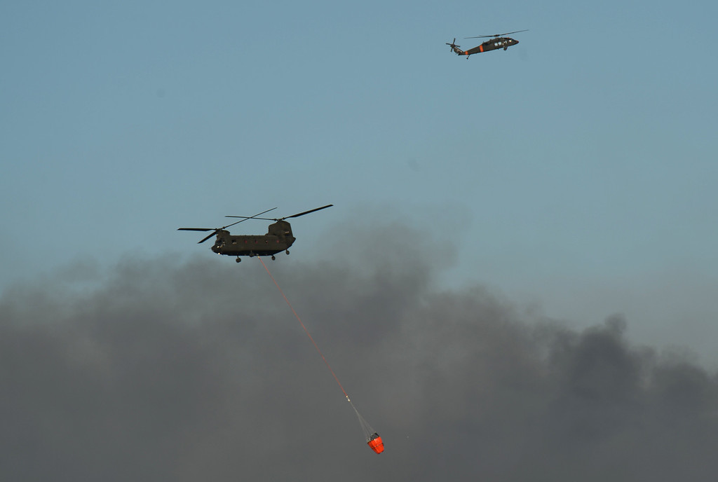 Description of . Colorado Springs, CO. - June 11: Helicopters are heading to the smoke covered BLack Forest area. Colorado Springs, Colorado. June 11, 2013. The fire is about 15 acres near the 12600 block of Peregrine Way near Black Forest Regional Park. (Photo By Hyoung Chang/The Denver Post)