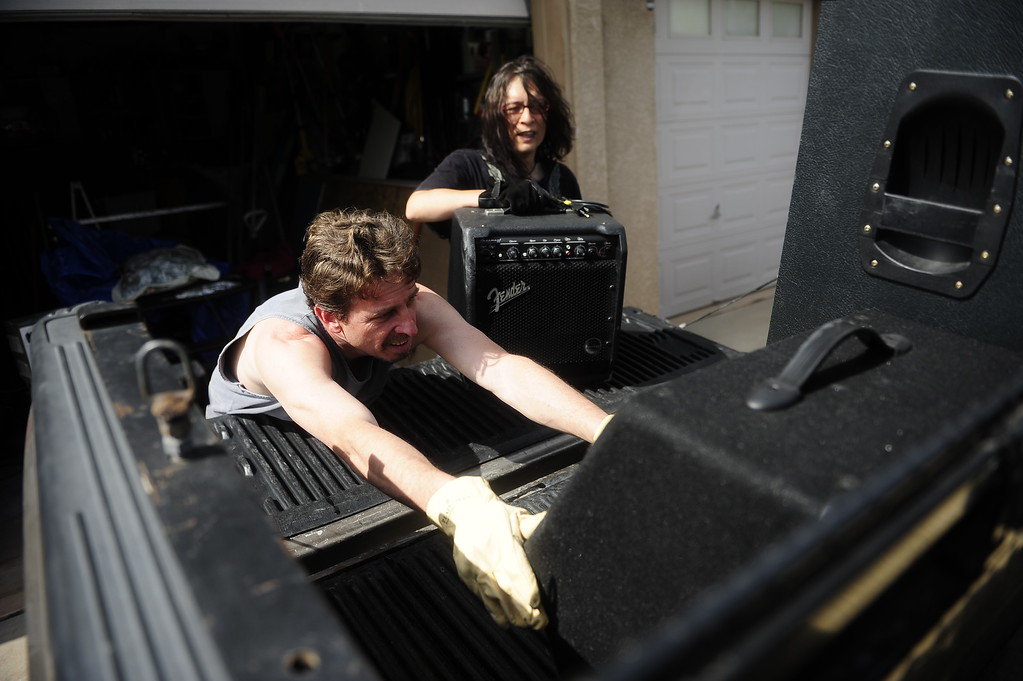 Description of . COLORADO SPRINGS - JUNE 13: Ron Vanackeren and M D\'Ziur move musical equipment out of Vanackeren\'s home while evacuating due to the Black Forest Fire on June 13, 2013. For the first time evacuations were issued within city limits of Colorado Springs. (Photo By Grant Hindsley / The Denver Post)