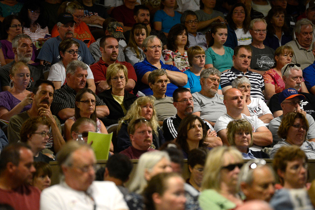 Description of . Black Forest fire evacuees listen intently to officials at a community meeting for current updates on the fire at Palmer Ridge High School in Monument Colorado June 15, 2013. (Photo By Andy Cross/The Denver Post)