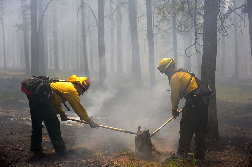 Description of . National Guard Firefighters help fight fire along Remington Road north of  Hodgen Road in the midst of the Black Forest Fire on June 13, 2013.  Photo by Helen H. Richardson/The Denver Post)