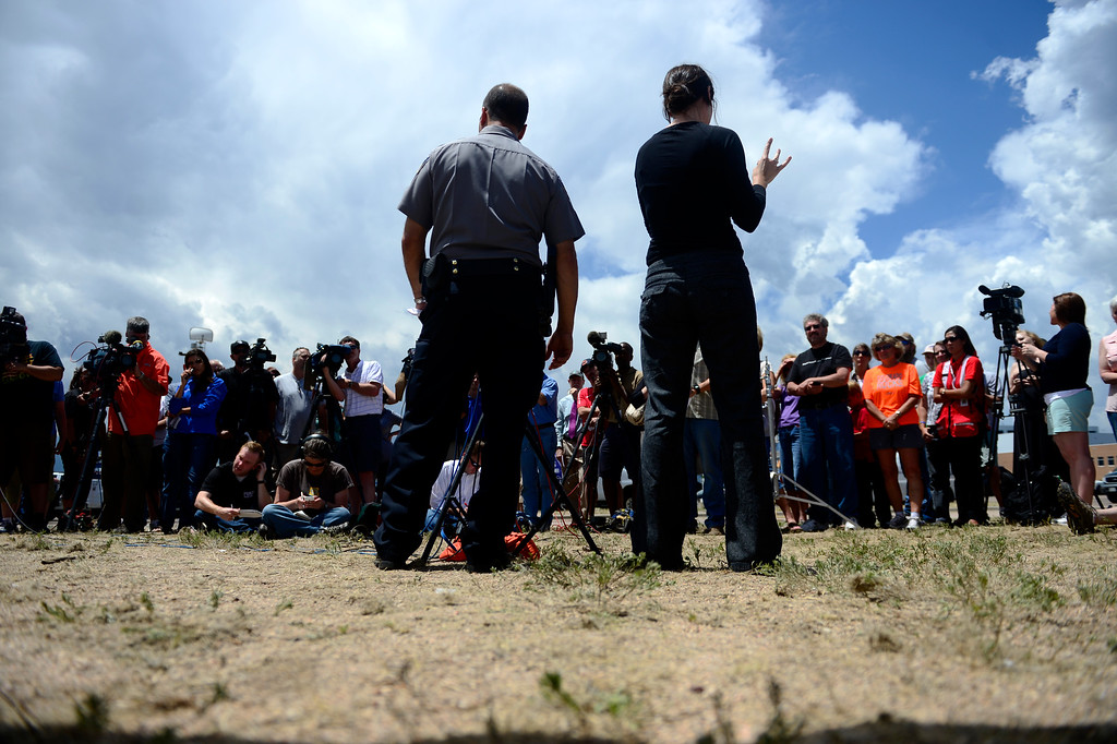 Description of . COLORADO SPRINGS, CO - JUNE 18: Sheriff Terry Maketa speaks as Ryan March signs during a press conference held by the El Paso County Sheriff to inform residents of their re-admittance status. Residents in Cathedral Pines were allowed in by 2 p.m., while residents between Vollmer and Herring Roads and Black Forest and Herring Roads both locations between Shoup Road and Kirk Road north-south will be allowed in for three hours. (Photo by AAron Ontiveroz/The Denver Post)