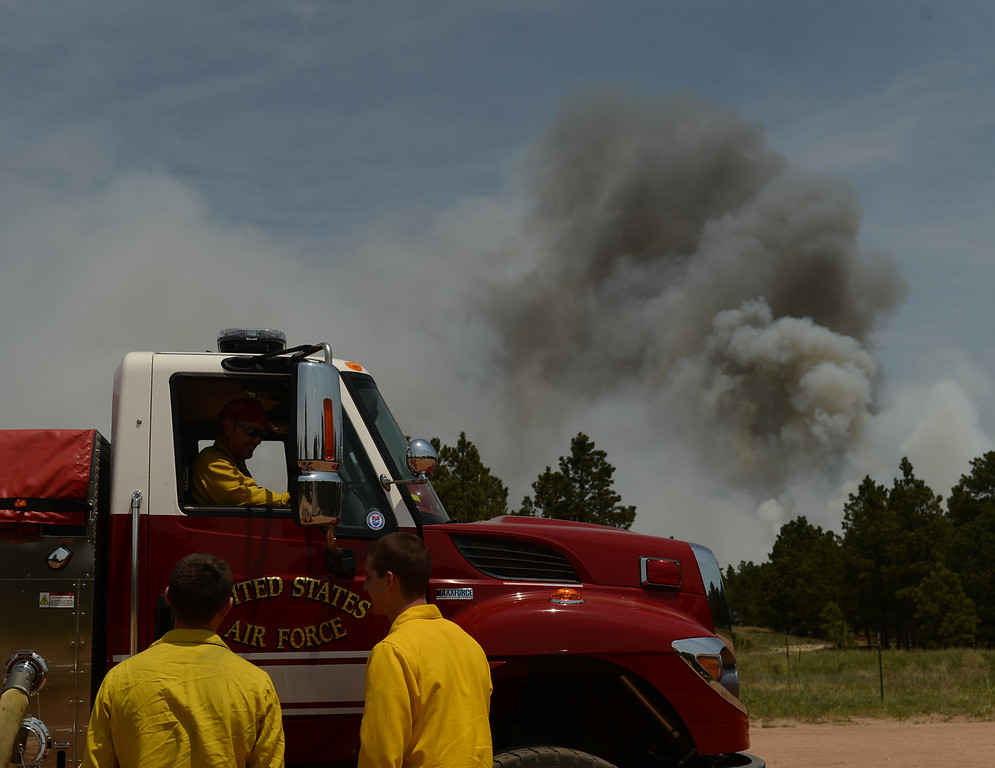 Description of . COLORADO SPRINGS, CO. - June 13: Air Force Academy Firefighters secure the Black Forest section 16 trailhead. Colorado Springs, Colorado. June 13, 2013. The Black Forest fire has already destroyed at least 360 homes and consumed 15,000 acres. (Photo By Hyoung Chang/The Denver Post)
