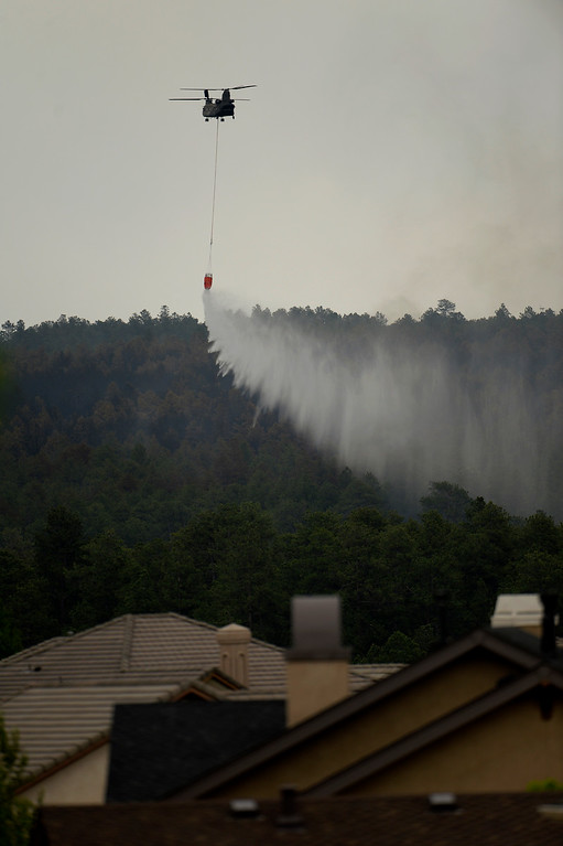 Description of . COLORADO SPRINGS, CO. - June 14: A CH-47 Chinook drops water near the Flying Horse sub station at the Black Forest Fire area Colorado Springs, Colorado. June 14, 2013 Denver, Colorado Springs. (Photo By Joe Amon/The Denver Post)