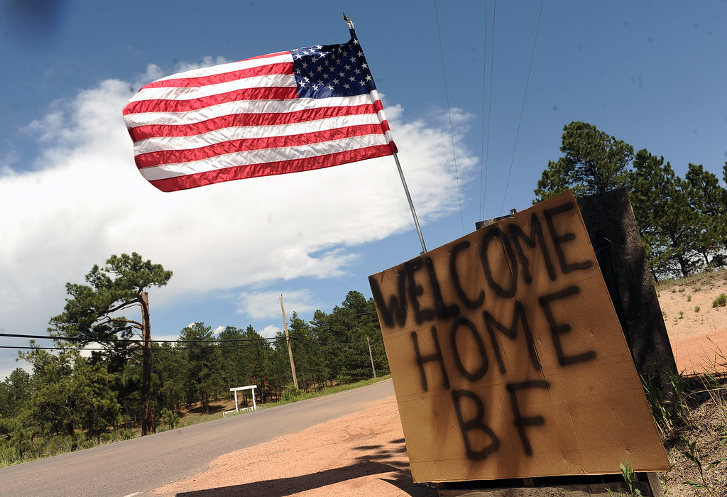 Description of . BLACK FOREST, CO - JUNE 18:  Signs welcome residents of Black Forest home along Burgess Road in Black Forest, CO on June 18, 2013.   Residents of Black Forest were finally allowed back into their burned homes for the first time since the fire devoured thousands of acres inside the Black Forest taking with it 502 homes and two lives.  Photo by Helen H. Richardson/The Denver Post)