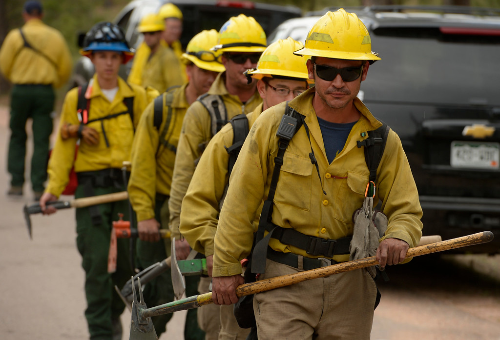 Description of . BLACK FOREST, CO - JUNE 17:   James Gonzales of Wildfire Support Team from Santa Fe, New Mexico, takes his team to another home where the crew scours the properties for any kind of hotspots  inside of the Black Fire fire zone in Black Forest, CO on June 17, 2013.  The fire is now 75% contained and recent rains are helping firefighters. Photo by Helen H. Richardson/The Denver Post)
