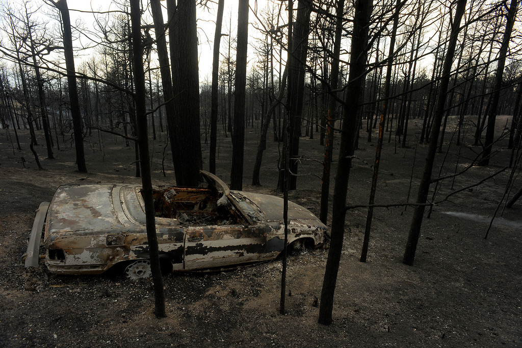 Description of . BLACK FOREST, CO - JUNE 13:  A burned car and landscape show the scope of the loss in the midst of the Black Forest Fire on June 13, 2013.  Photo by Helen H. Richardson/The Denver Post)