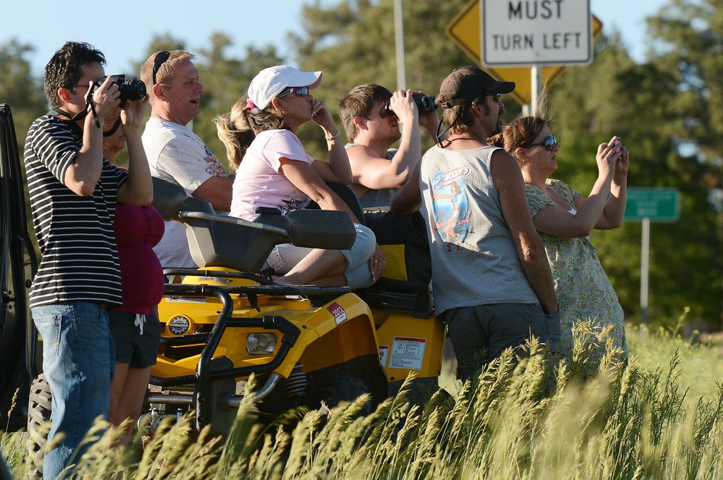 Description of . Colorado Springs, CO. - June 11: People are watching the smoke covered BLack Forest area. Colorado Springs, Colorado. June 11, 2013. The fire is about 15 acres near the 12600 block of Peregrine Way near Black Forest Regional Park. (Photo By Hyoung Chang/The Denver Post)