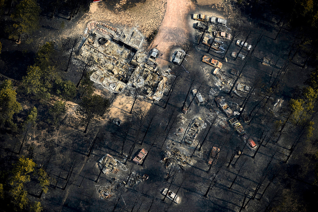 Description of . Little is left of a home and its property along the east edge of the Black Forest fire on June 13, 2013. As people learned whether their homes survived, the fire continued to burn through the community of about 13,000 people, where pine trees were harvested in the 1800s to build the cities of Colorado Springs and Denver.