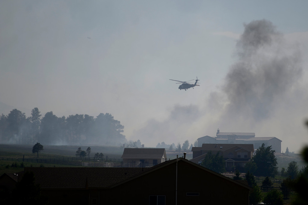 Description of . COLORADO SPRINGS, CO - JUNE 12: A helicopter flies overhead near the north end of the Black Forest Fire east of Colorado Springs. (Photo by AAron Ontiveroz/The Denver Post)