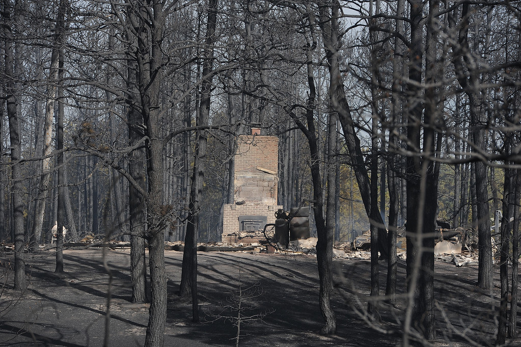 Description of . COLORADO SPRINGS, CO - JUNE 12: Blackened and charred homes are seen along Herring Road in the Black Forest area northeast of Colorado Springs, CO on June 12, 2013. Temperatures are expected to be in the nineties again today.  Photo by Helen H. Richardson/The Denver Post)
