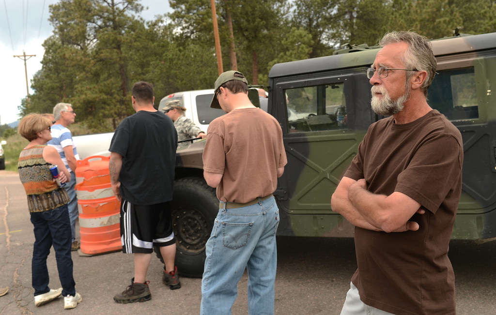 Description of . Black Forest Fire evacuee Keith Steppe, right, is waiting for the El Paso County Sheriff\'s escort to his property for at the corner of Vollmer Rd. and Burgess Rd., Colorado Springs, Colorado, June 14, 2013.  (Photo By Hyoung Chang/The Denver Post)