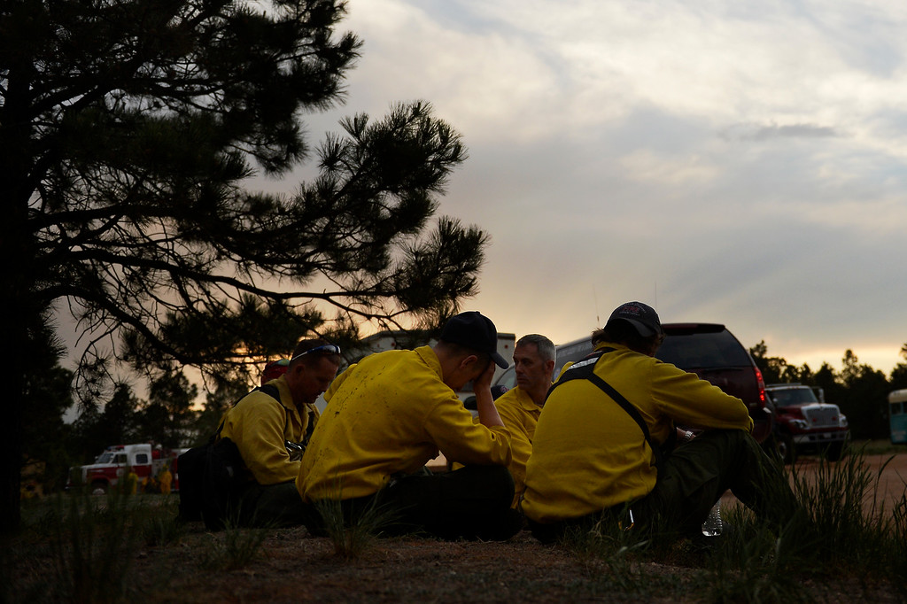 Description of . COLORADO SPRINGS, CO. - June 13: Firefighters rest at Black Forest trail head section16 near the corner of Burgess Rd and Buckskin Ln along the edge of the Black Forest Fire Colorado Springs, Colorado. June 13, 2013 Denver, Colorado Springs. (Photo By Joe Amon/The Denver Post)