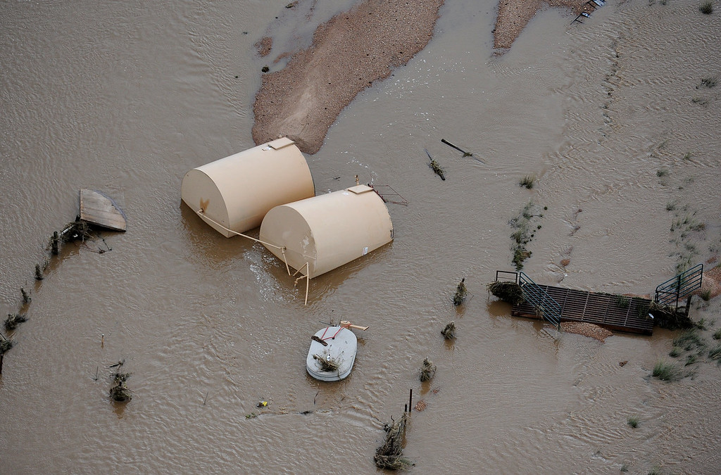 Description of . Debris from an destroyed drilling operation near Greeley in water flooded by the South Platte River. Aerial photographs of the Platte River flooding cities and farms in Weld County Colorado. (Photo By Tim Rasmussen/The Denver Post)