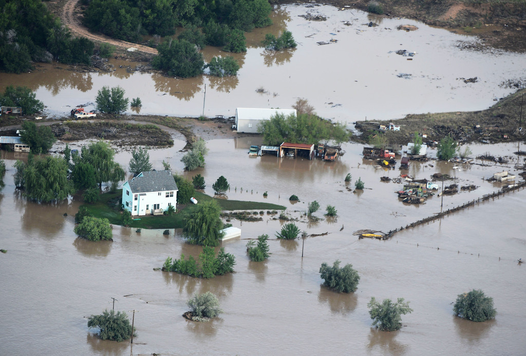 Description of . Flooded land in Weld County Colorado near Milliken Colorado Saturday morning. (Photo By Andy Cross/The Denver Post)