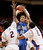 Air Force's Todd Fletcher (10) shoots over Boise State's Derrick Marks (2) and Ryan Watkins (0) during the first half of an NCAA college basketball game, Wednesday, Feb. 20, 2013, in Boise, Idaho. (AP Photo/Matt Cilley)